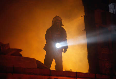 A rescuer search an accident victim in a smoke Stock Photo