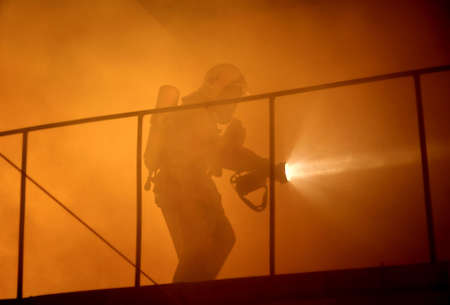 A rescuer search an accident victim in a smoke