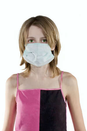 Girl in a protective mask. White background photo