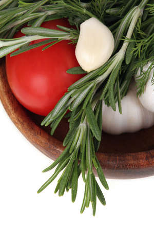 sause: Tomato, garlic and rosemary in bowl on white background.