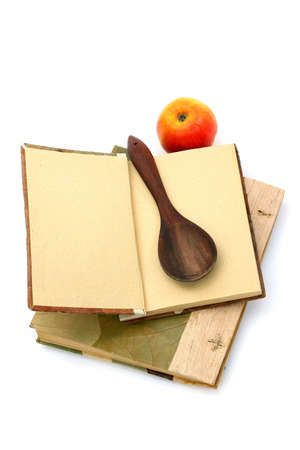 Cookbooks, apple and spoon isolated on white background. .Place for your recipe
