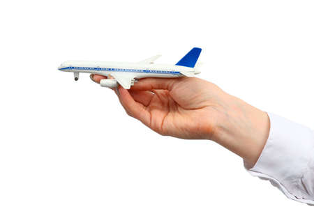 Toy airplane in hand.  Isolated on white background. photo