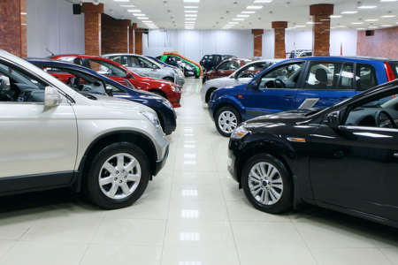 New fuel efficient SUVs on a car dealers lot for sale. Stock Photo