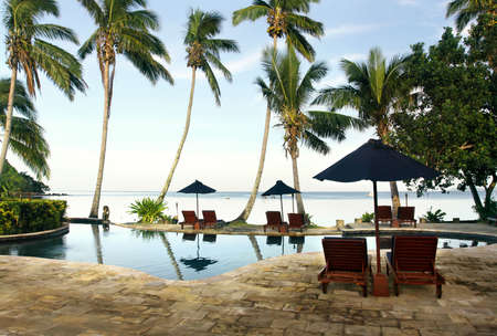 tropical paradise: Morning in tropical paradise. View to swimming pool and sea