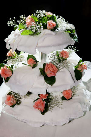 Original three tiered wedding cake isolated on black.  photo