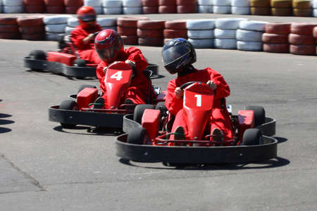 Go cart racers struggling at the piste. photo