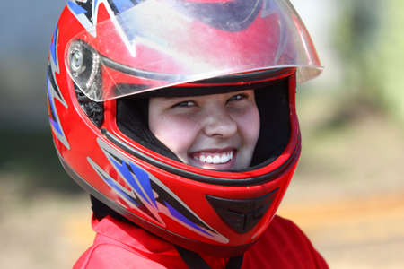 A smiling young  racer photo