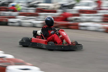 Go cart racer struggling at the piste photo