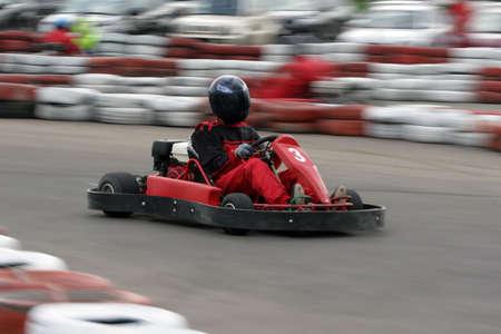 Go cart racer struggling at the piste
