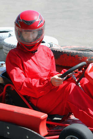 A smiling young  racer. Go-carting photo
