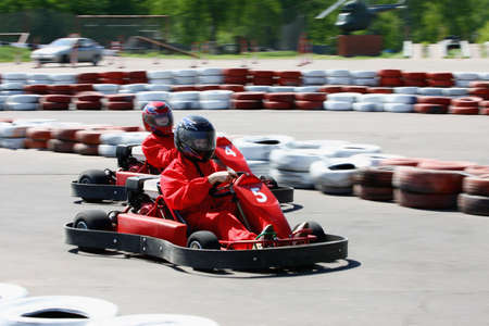 Go cart racers struggling at the piste photo