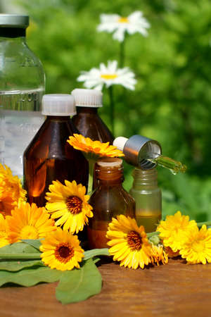 tincture: Medical calendula. Essential oil and tincture - beauty treatment.