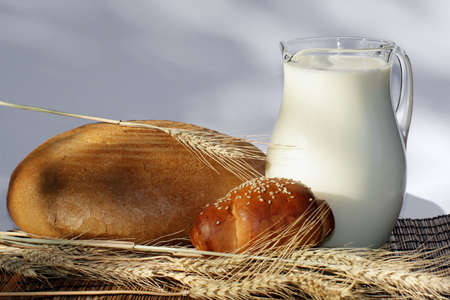 Bread and jug with milk  photo