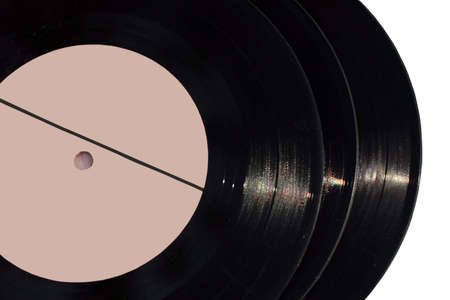 Close-up vintage vinyl record  on white background  photo