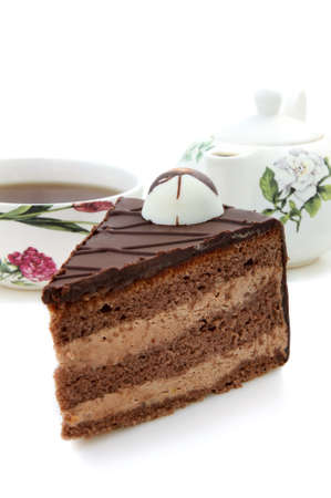 fudge: Slice of chocolate cake  and cup of tea on white background Stock Photo