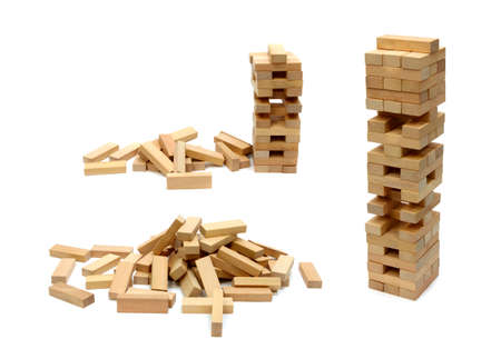 Building and scattered from wooden blocks. Isolated on white background Stock Photo