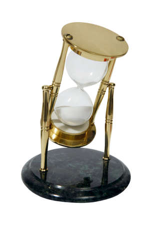 A hourglass is an invertible device with two connected glass bulbs containing sand that takes an hour to pass from the upper to the lower bulb. photo
