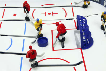 Hockey players on the ice field background. Board game.