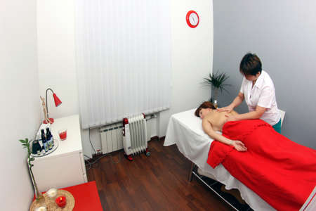 A young woman getting massage and relaxation in spa salon. photo