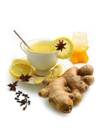Ginger tea with lemon, honey and  spices isolated on white background photo