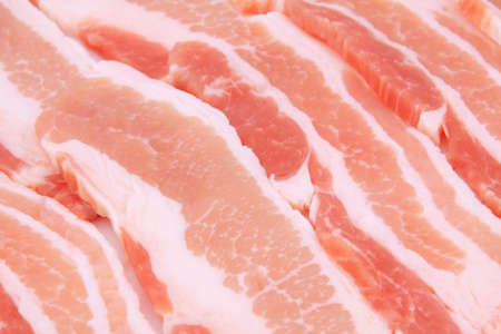 uncooked bacon: Background of raw bacon rashers