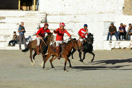 A polo players charge after the ball at a match in Lehs polo grounds on September 3, 2011, in Leh, Ladakh.