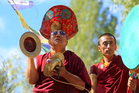 LADAKH - SEPTEMBER 6: Buddhist monks play ritual music on percussion instruments during the praying ceremony on September 6, 2011 in  Leh