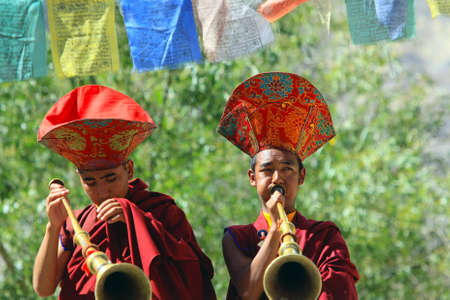 LADAKH - SEPTEMBER 6: Buddhist monks play ritual music on trumpets during the praying ceremony on September 6, 2011 in  Leh