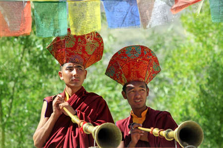 gompa: LADAKH - SEPTEMBER 6: Buddhist monks play music on trumpets during the praying ceremony on September 6, 2011 in  Thiksey Gompa, Ladakh, India.