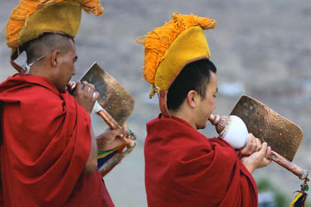 LADAKH - SEPTEMBER 4: Buddhist monk play  ritual music on tibetan conchs during the morning ceremony on September 4, 2011 in  Thiksey Gompa, Ladakh, India.