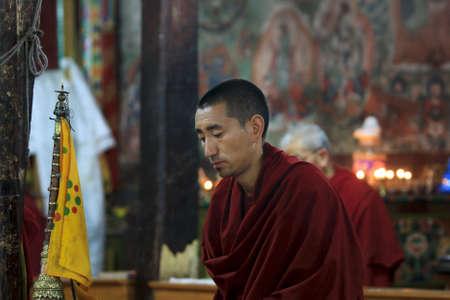 LADAKH - SEPTEMBER 4: Buddhist monk prays on the morning ceremony on September 4, 2011 in  Thiksey Gompa, Ladakh, India.