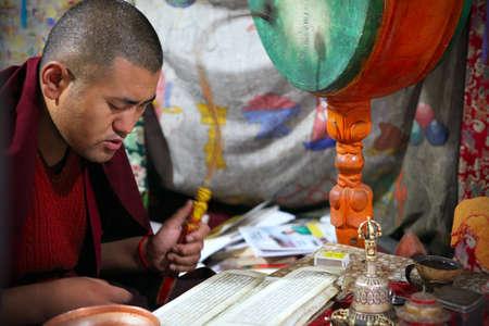 chanting: LADAKH - SEPTEMBER 4: Buddhist monk prays on the morning ceremony on September 4, 2011 in  Thiksey Gompa, Ladakh, India.