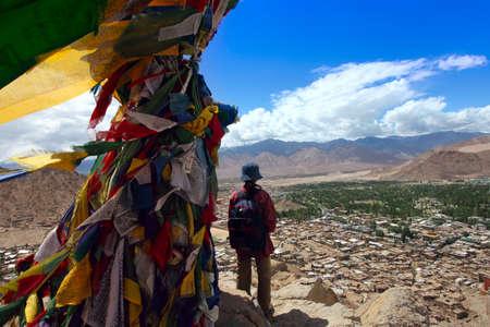 ladakh: Tourist girl enjoying the views of a mountains landscape. Tourism travel vacation concept. Stock Photo