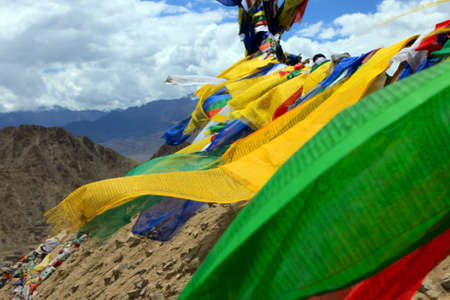 ladakh: Praying flags floating in the wind on mountain background. Himalaya