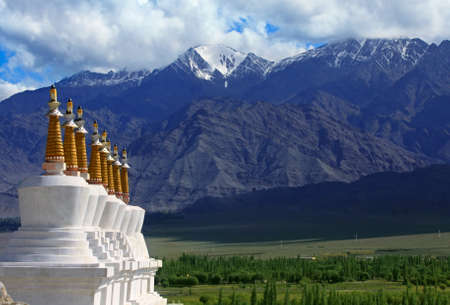 Landscape with a row of Stupas and green valley of the mountain background. Himalaya