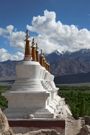 Landscape with a row of Stupas and green valley of the\ mountain background. Himalaya