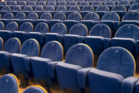 Empty cinema auditorium with lines of blue chairs  photo
