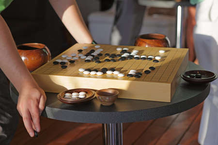strategical: Detail of traditional chinese boardgame Go  Stock Photo
