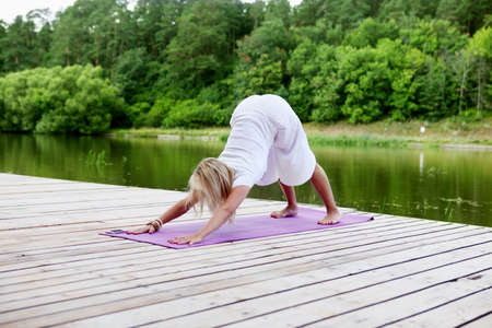 stance: Young woman practising yoga exercise  Stock Photo
