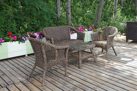 Rattan chairs and table  in empty cafe photo