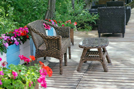 Rattan chair and table  in empty cafe photo