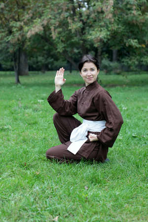 chi kung: Zen pretty woman practicing exercise kung fu, chi kung or tai chi  in natural park