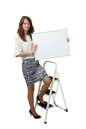 advertize: A young woman holding banner Isolated on white background