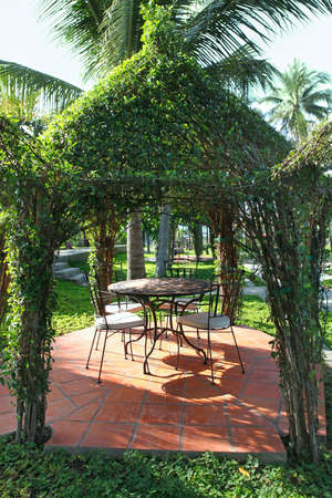 arbor: Beautiful green gazebo pavilion in the resort garden