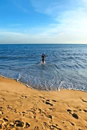 Sea, sand and couple  on a tropical beach photo