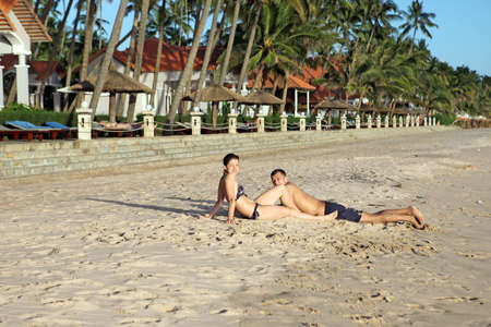 A happy young man and women on the tropical beach photo