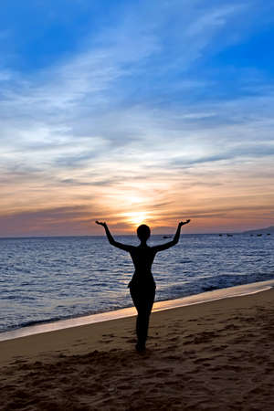 dancing silhouette: Silhouette young beautiful woman  on a beach. Sunset Stock Photo