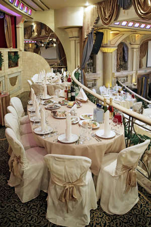 Restaurant interior with served tables photo
