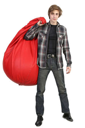 large bean: Full length portrait of young man standing with big bean bag on white background Stock Photo