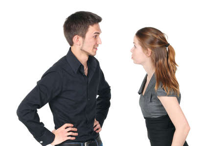 Young caucasian couple arguing on white background photo